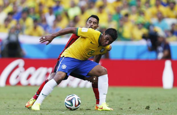 Paulinho (right) shields the ball from Mexico's Jose Juan Vazquez (left). Picture: Action Images