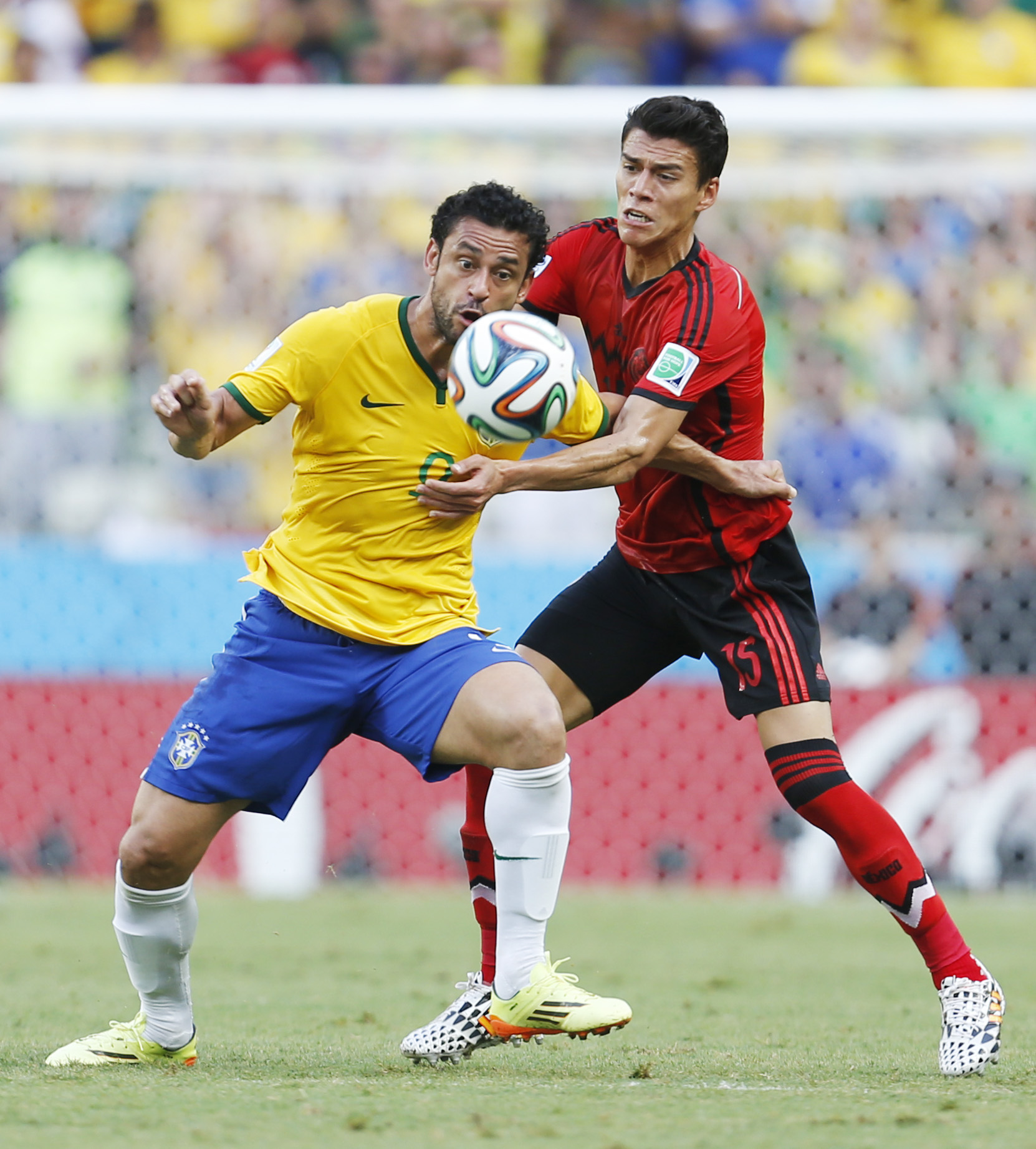 Hector Moreno (right) grapples with Brazil striker Fred (left). Picture: Action Images