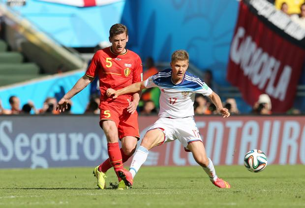 Jan Vertonghen (left) battles with Russia's Oleg Shatov (right). Picture: Action Images