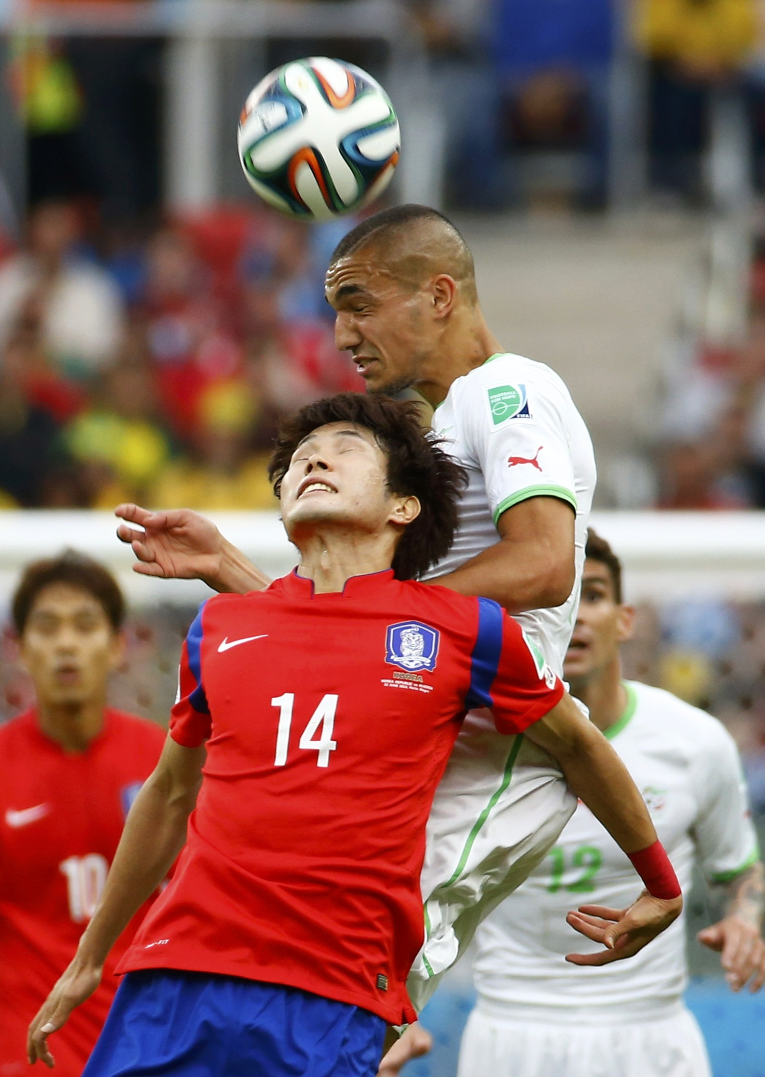 Nabil Bentaleb battles in the air with Han Kook-young. Picture: Action Images