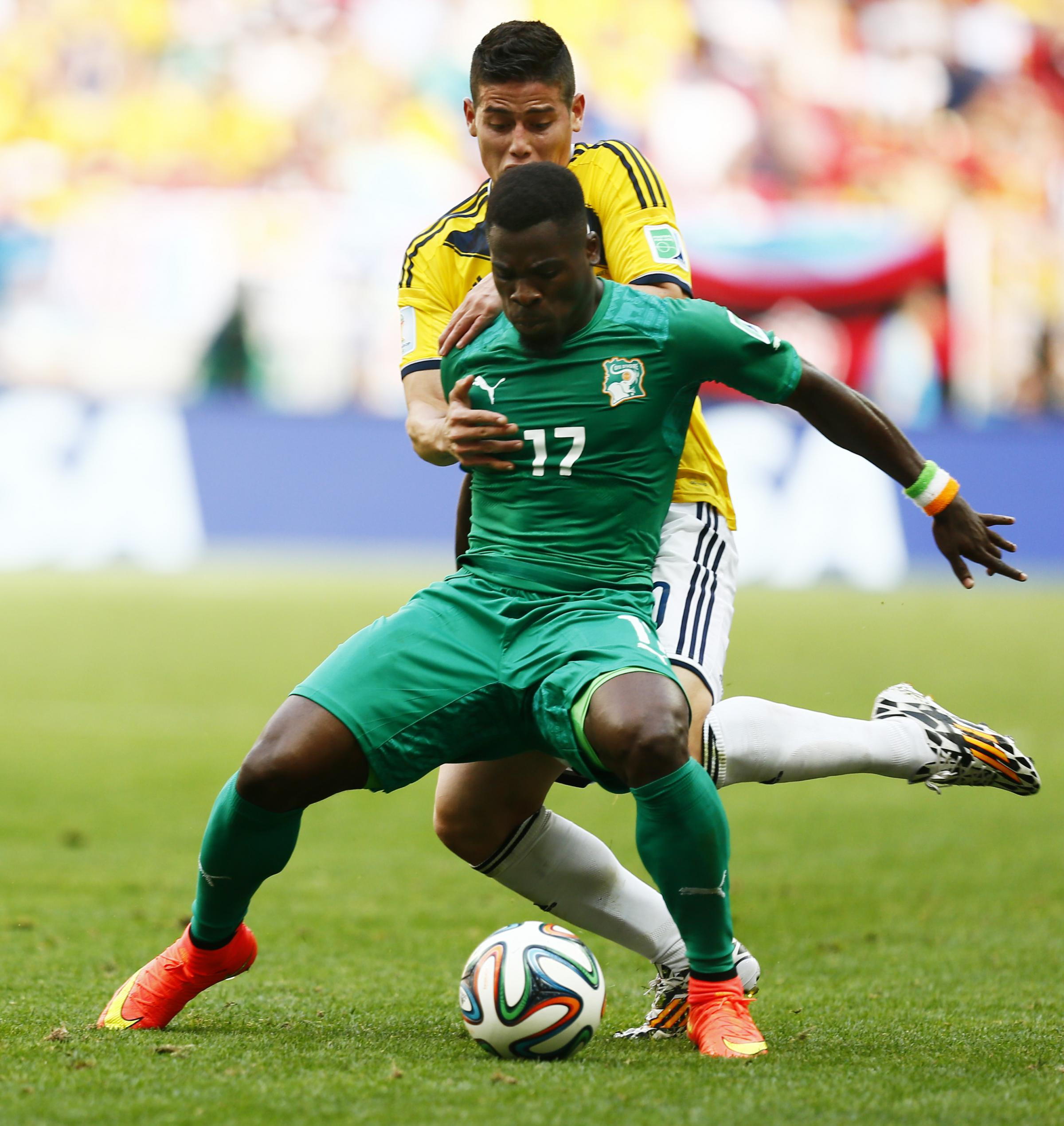 Serge Aurier holds off Colombia's James Rodriguez. Picture: Action Images