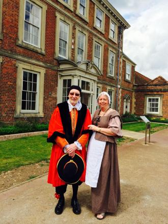 Sir Nicholas Rainton with a maid ready to welcome guests to Forty Hall