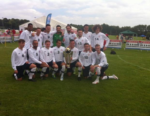 Enfield Independent: The victorious Enfield squad pose with the winners' trophy.