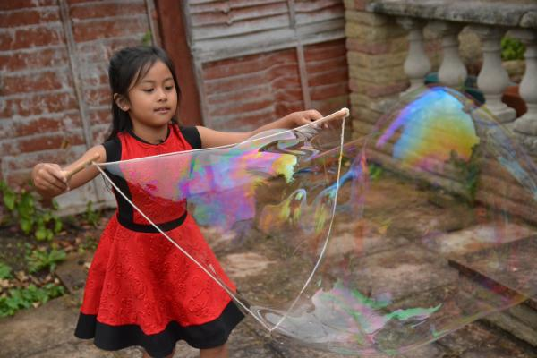 Family blowing bubbles in the name of science