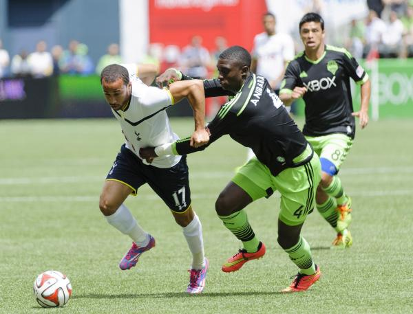 Andros Townsend (left) looks to escape the attentions of Sounders' Jalil Anibaba. Picture: Action Images