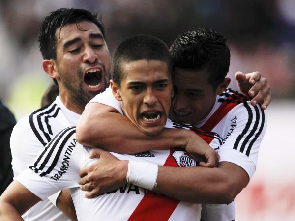 Manuel Lanzini (centre) is mobbed after scoring for River Plate last term. Picture: Action Images