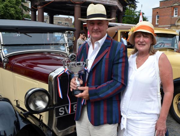 Peter Read with his trophy and vintage car