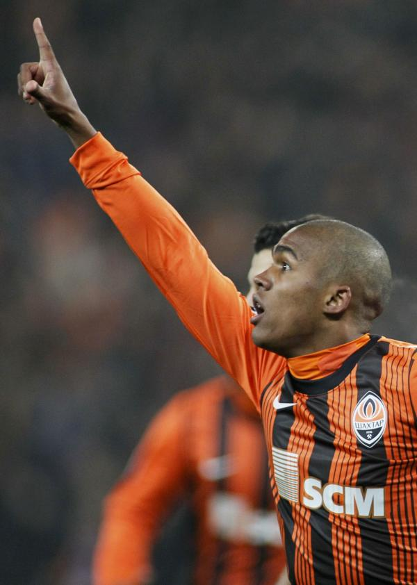 Douglas Costa celebrates a goal for Shakhtar last season. Picture: Action Images