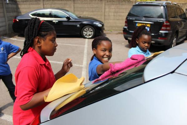 Children helping out at the Revival Christian Church's car wash day