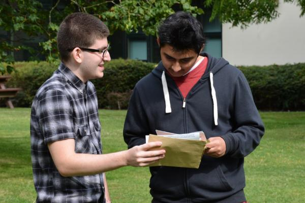 Reiss Greenblatt (left) shows off his A*A* A results