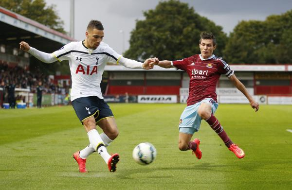 Tottenham Hotspur's Ryan Fredericks (left) and West Ham United's Dan Potts. Picture: Action Images