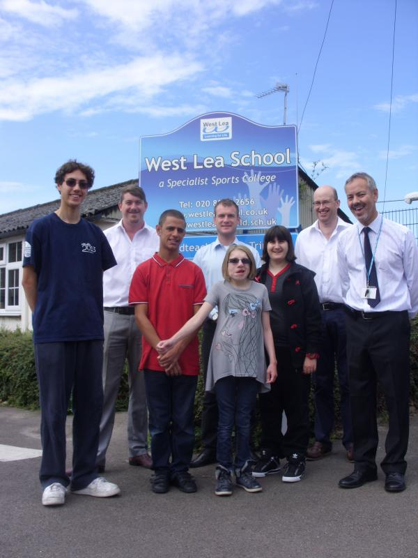 Pupils at West Lea school and driving instructors outside the school