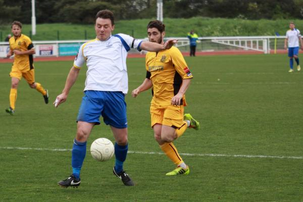Bradley Quinton (white shirt) in action for Enfield Town last season. Picture: Tom Scott