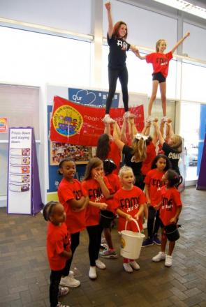 Fame All Star cheerleading team performing at Ponders End Tesco