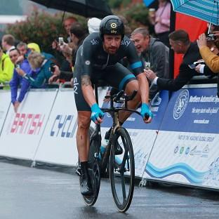Sir Bradley Wiggins will be back to defend the title he won in last year