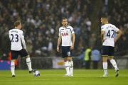 Action Images. Kane, Eriksen and Bentaleb standing over the ball after conceeding the second goal