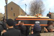 Family members carrying Shaquan Sammy-Plummer's coffin