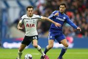 Ryan Mason jostles with Chelsea's Cesc Fabregas in the League Cup Final. Picture: