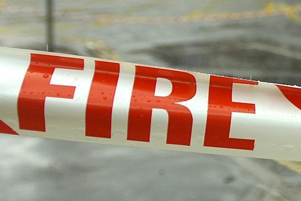 Two men were killed and another wounded in a fire that engulfed a caravan