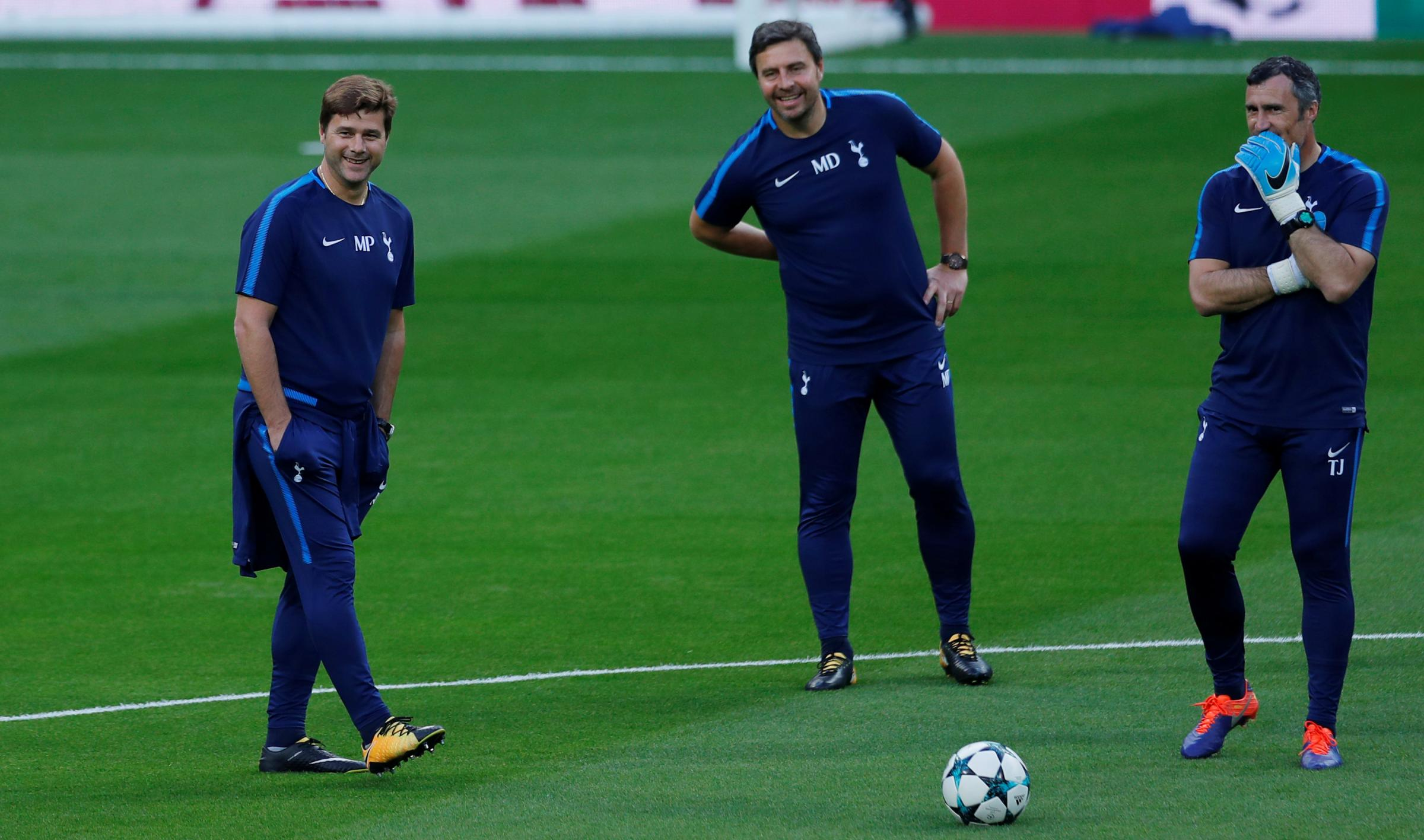 A relaxed Mauricio Pochettino with his staff as Spurs train at the Bernabeu. Picture: Action Images