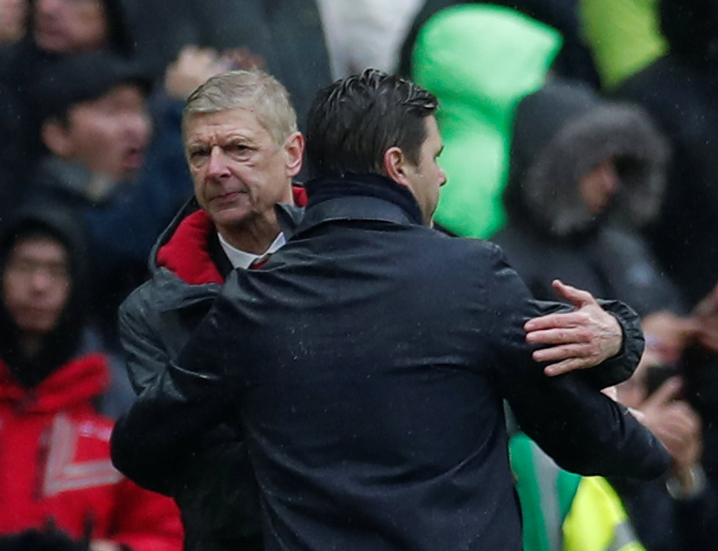 Shaking hands: Mauricio Pochettino and Arsene Wenger at the end of today's game. Picture: Action Images