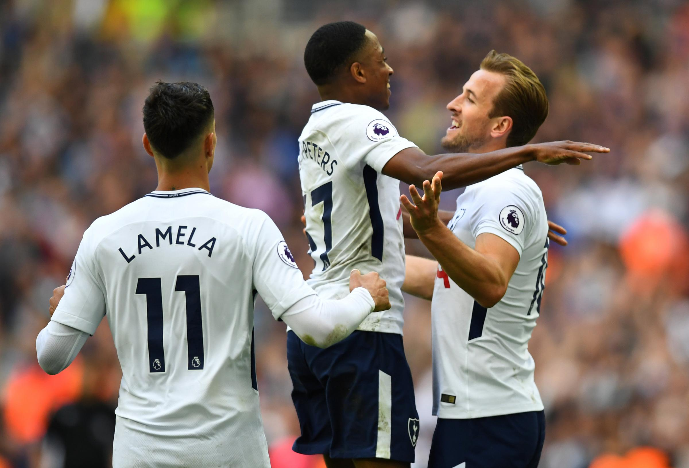 Kyle Walker-Peters celebrates with Harry Kane in yesterday's 5-4 win over Leicester. Picture: Action Images