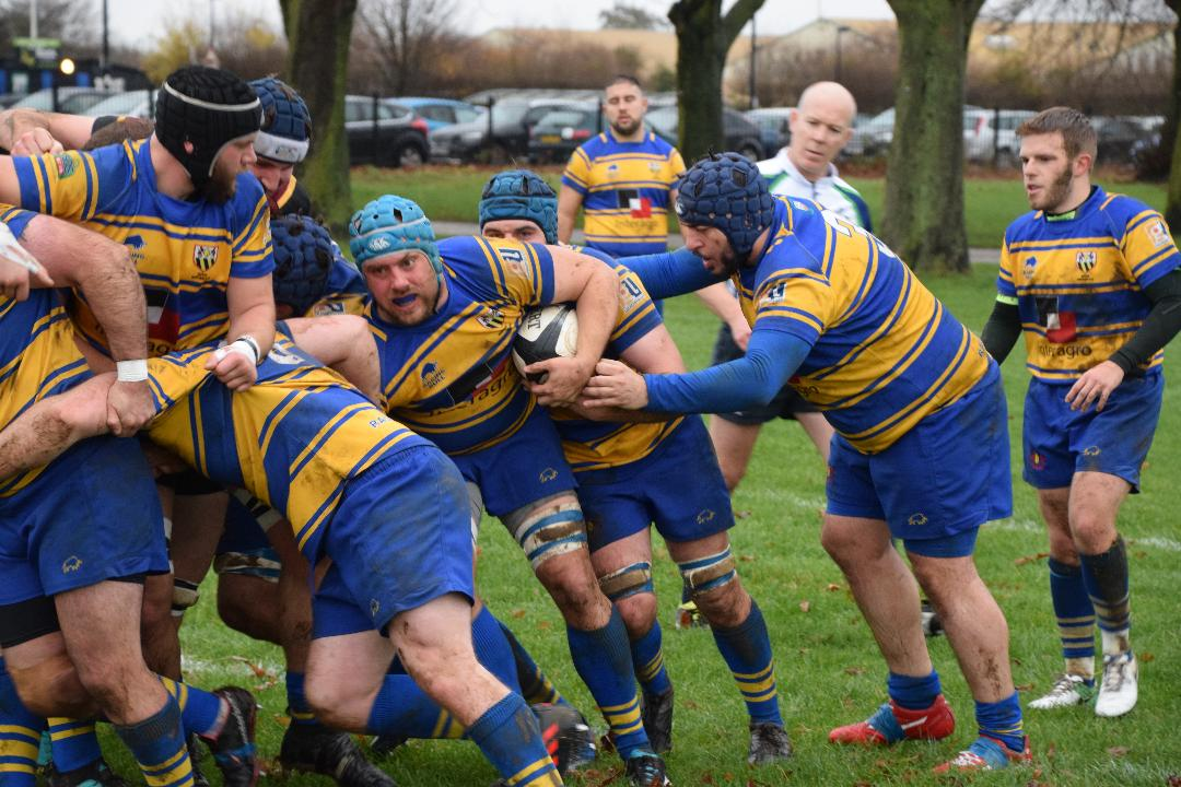 Man-of-the-match Wes Warren (blue scrum cap) in the thick of it against Hampstead