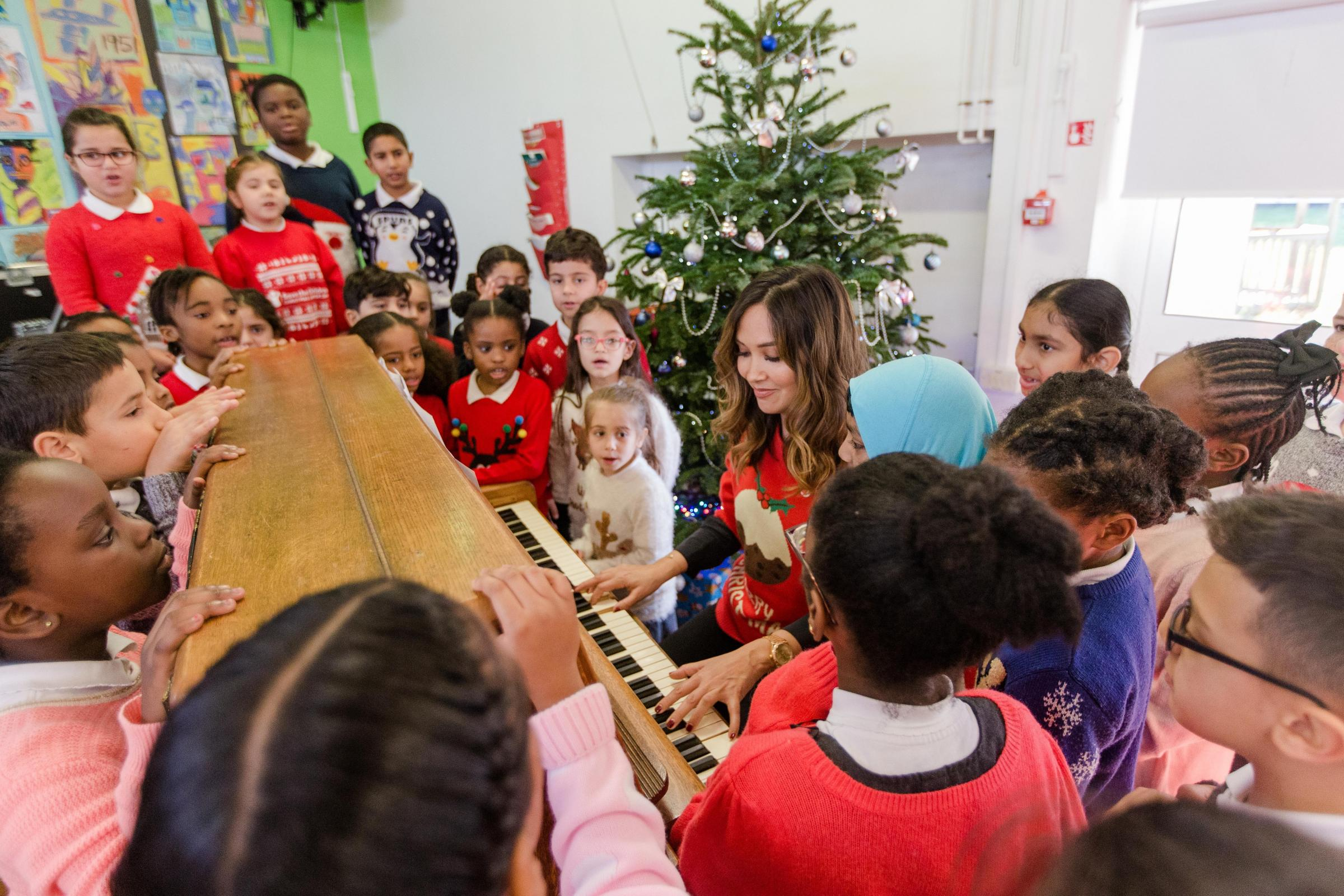 TV and Radio Presenter and Save the Children Ambassador visited a Save the Children Families Connect programme and hosted a Klassy Christmas Jumper Jam with year three pupils at Cuckoo Hall Primary School in Enfield, London, all in celebration of the char