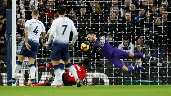 Hugo Lloris thwarts Paul Pogba during Spurs' defeat on Sunday. Picture: Action Images
