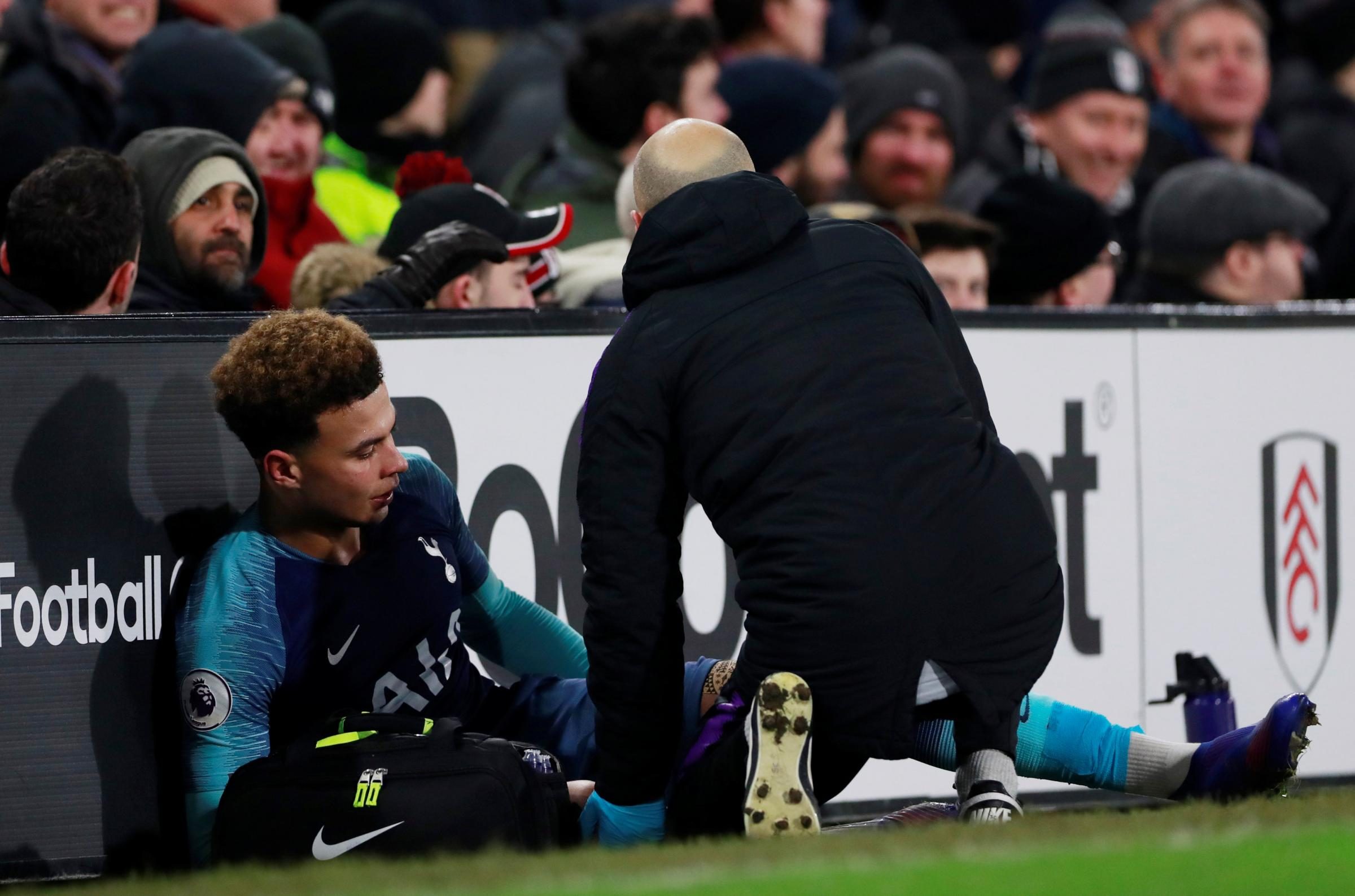 Dele Alli receives treatment on his injury. Picture: Action Images