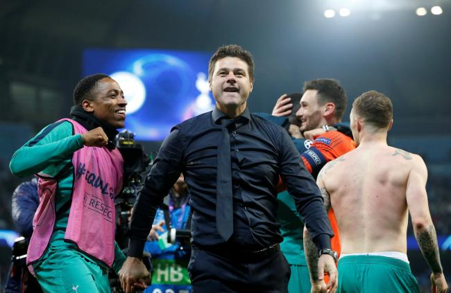A euphoric Mauricio Pochettino celebrates with his players. Picture: Action Images