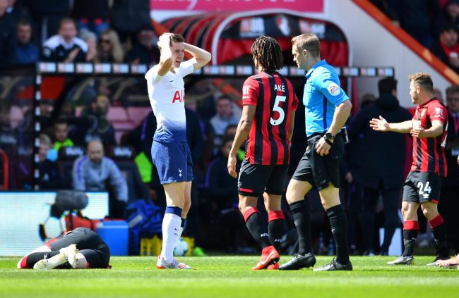 Juan Foyth holds his head in his hands after being sent off by Craig Pawson. Picture: Action Images