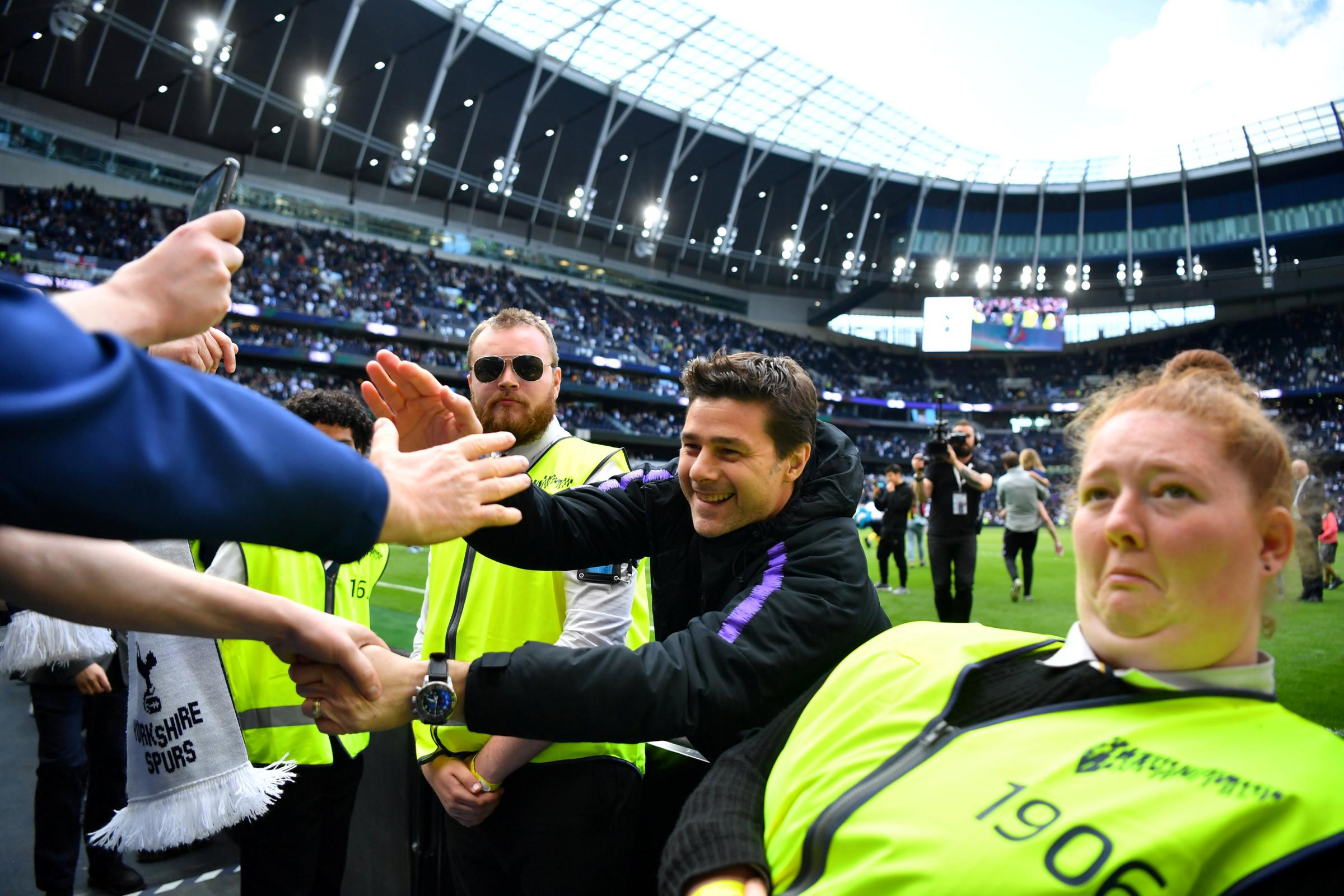 Mauricio Pochettino greets fan after Spurs' final Premier League game of the season. Picture: Action Images